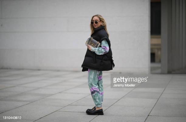 Sonia Lyson poses wearing Pull & Bear tie dye jogging suit, black The Frankie Shop vest, black Gucci loafers and Dior Caro bag on March 29, 2021 in...