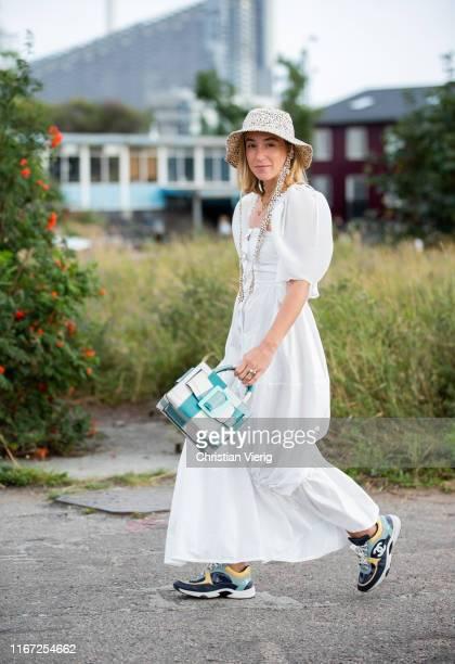 Sonia Lyson seen wearing bucket hat, white dress, Boyy bag outside Cecilie Bahnsen during Copenhagen Fashion Week Spring/Summer 2020 on August 07,...