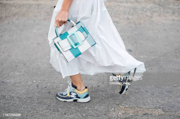 Sonia Lyson seen wearing Chanel sneakers white dress Boyy bag outside Cecilie Bahnsen during Copenhagen Fashion Week Spring/Summer 2020 on August 07...