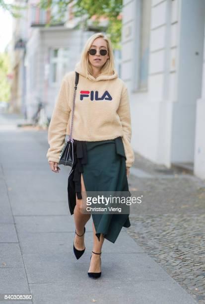 Sonia Lyson wearing a beige fleece fake teddy cropped Fila hoody velvet pumps Jimmy Choo black green KAN I Fendi bag a fendi skirt Ray Ban sunglasses...
