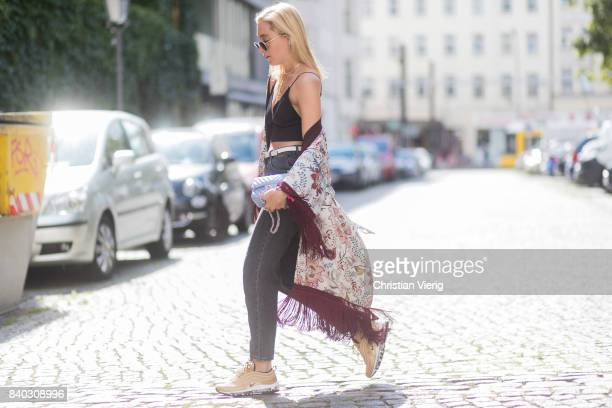 Sonia Lyson wearing a black cropped top golden Nike Air Max sneakers grey HM mom jeans blue Chanel bag kimono with floral print Zara Chanel Louis...