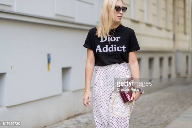 Sonia Lyson wearing a black Dior tshirt with the print Dior Addict cropped wide leg Topshop pants a Pinko bag with the print Love me Tender Dior...