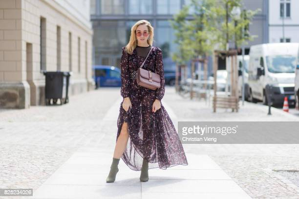 Sonia Lyson wearing a boho dress with long sleeves from Tara Jarmon, vintage belt, pink Valentino bag, olive green heeled boots Topshop, pink Vogue x...