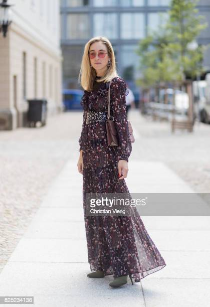 Sonia Lyson wearing a boho dress with long sleeves from Tara Jarmon vintage belt pink Valentino bag olive green heeled boots Topshop pink Vogue x...