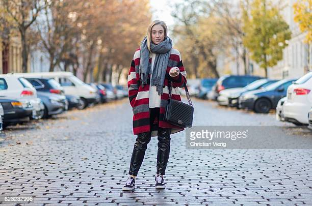Sonia Lyson wearing a creme Zara cashmere sweater a red white black grey striped wool coat from Isabel Marant via The Corner Berlin a grey Acne scarf...