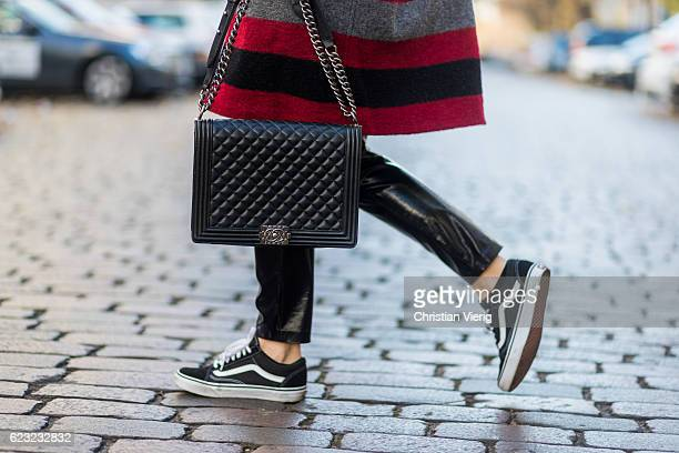 Sonia Lyson wearing a red white black grey striped wool coat from Isabel Marant via The Corner Berlin black PVC Zara pants black Vans sneakers via...
