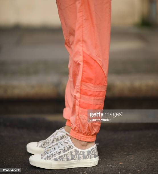 Sonia Lyson wearing Adidas orange trackpants and Dior sneaker on May 26 2020 in Berlin Germany