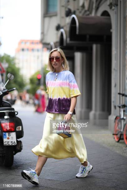 Sonia Lyson wearing Adidas sneaker, Boyy bag, Zara tie dye shirt on July 01, 2019 in Berlin, Germany.