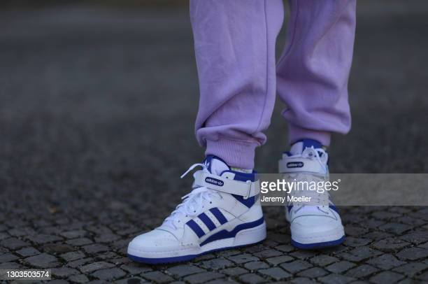 Sonia Lyson wearing Adidas white and blue Forum84 sneaker, Monki lilac joggingpants on February 21, 2021 in Berlin, Germany.