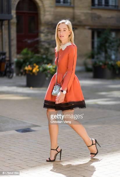 Sonia Lyson wearing an orange Fendi cocktail dress, a pastel Fendi micro peekaboo leather bag, Jimmy Choo high heels on July 18, 2017 in Berlin,...