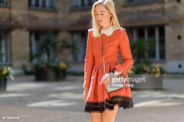 Sonia Lyson wearing an orange Fendi cocktail dress a pastel Fendi micro peekaboo leather bag Jimmy Choo high heels on July 18 2017 in Berlin Germany