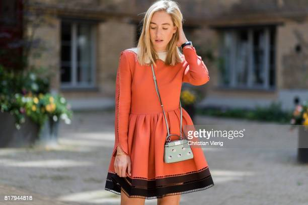 Sonia Lyson wearing an orange Fendi cocktail dress a pastel Fendi micro peekaboo leather bag Jimmy Choo high heels on July 18 2017 in Berlin Germany