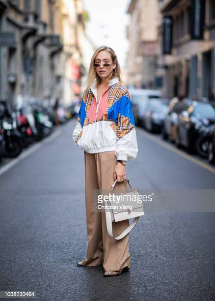 Sonia Lyson wearing beige pants beige Max Mara pants jacket Burberry bag Fendi sunglasses Fendi snake boots Gucci hair clip is seen during Milan...