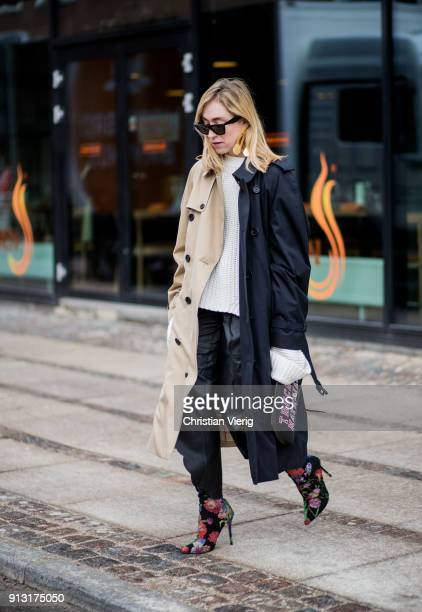 Sonia Lyson wearing black beige trench coat during the Copenhagen Fashion Week Autumn/Winter 18 on February 1 2018 in Copenhagen Denmark