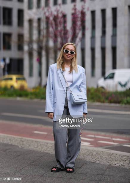 Sonia Lyson wearing black Chanel sandals, baby blue Louis Vuitton leather bag, white Prada shades, blue Edited blazer, grey Zara pants and white H&M...