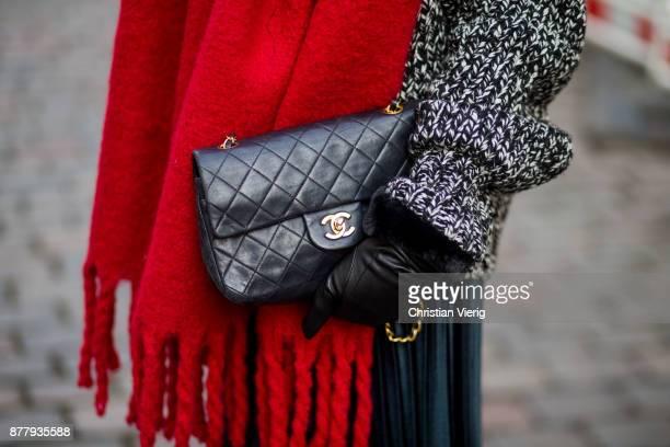 Sonia Lyson wearing black leather vintage hat black ankle boots with fur Jimmy Choo black Chanel bag pleated midi skirt zara grey knit Zara black...