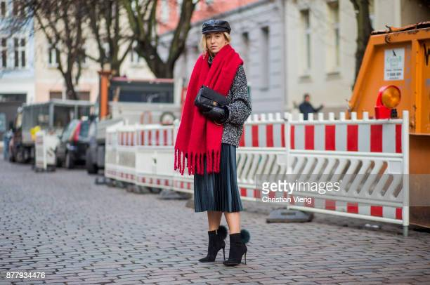 Sonia Lyson wearing black leather vintage hat red Zara scarf black ankle boots with fur Jimmy Choo black Chanel bag pleated midi skirt zara grey knit...