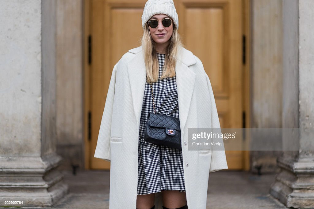 Sonia Lyson (@soniafrancex / PR Manager) wearing black overknees boots Stuart Weitzman, a grey white checked plaid dress Zara, a white wool coat Lala Berlin, a white wool hat &other stories, Ray Ban sunglasses, black Chanel bag on November 26, 2016 in Berlin, Germany.