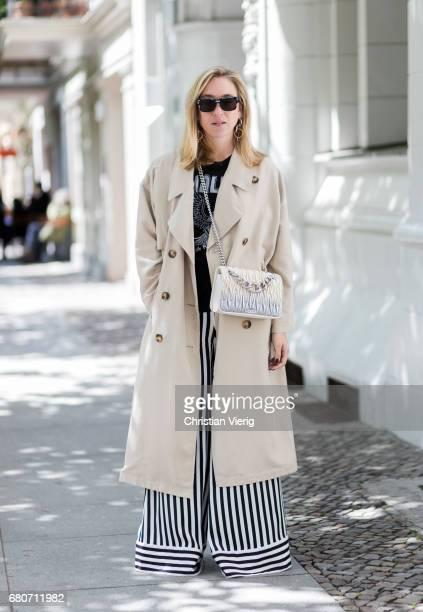 Sonia Lyson wearing black white striped wide leg pants By Malene Birger fluffy fake fur shoes By Malene Birger Local Authority tshirt black Dior...