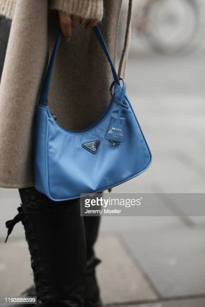 Sonia Lyson wearing boots short and coat Zara sweater and cardigan Edited Gucci bucket hat and Prada bag on December 12 2019 in Berlin Germany