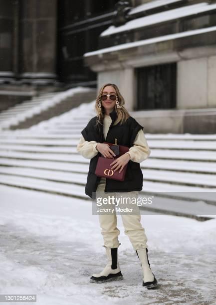 Sonia Lyson wearing Bottega Veneta beige boots, Edited beige jogging suit, The Frankie Shop black vest, Dior bordeaux bag, Linda Farrow shades chain...