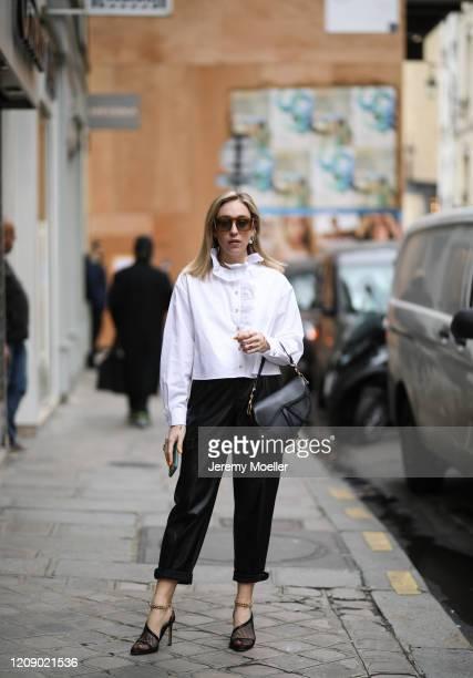 Sonia Lyson wearing Bottega Veneta heels Mango leather pants Zara blouse Dior saddle bag and Fendi sunglasses on February 25 2020 in Paris France