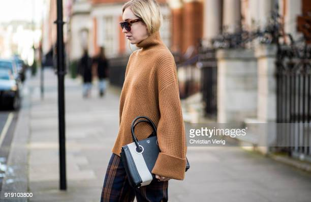 Sonia Lyson wearing brown knit plaid wide leg pants heels other stories MCM bag Celine sunglaasses seen during London Fashion Week February 2018 on...