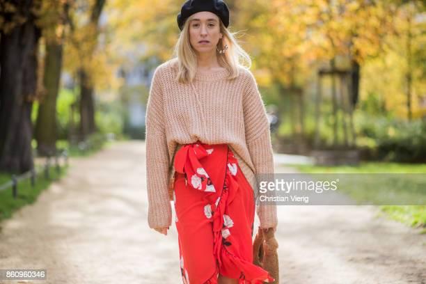 Sonia Lyson wearing brown Loeffler Randall teddy fake fur bag red ruffled skirt Gannix x Anita Hass oversized cashmere sweater Zara black sock boots...