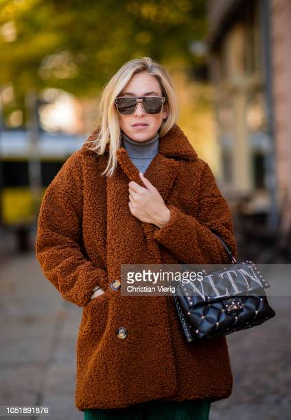 Sonia Lyson wearing brown teddy coat Dior sunglasses Valentino bag on October 11 2018 in Berlin Germany