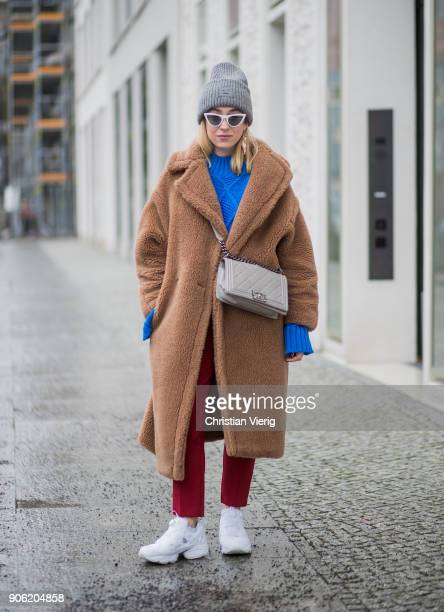 Sonia Lyson wearing brown teddy coat Max Mara red pants blue cropped jumper Topshop white sneaker Reebok grey Chanel bag Gucci belt Acne beanie white...