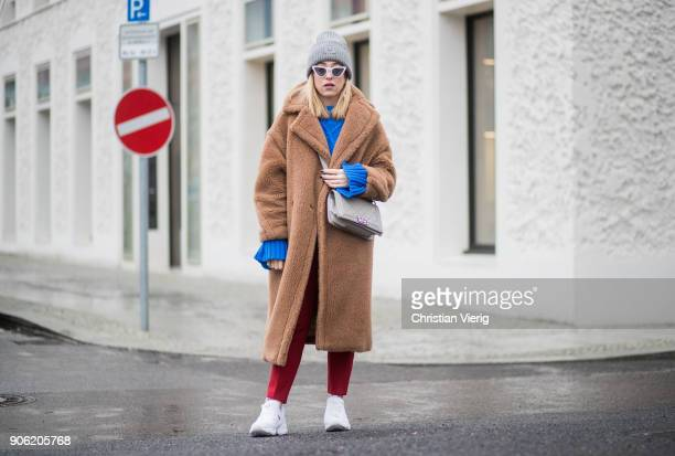Sonia Lyson wearing brown teddy coat Max Mara red pants blue cropped jumper Topshop white sneaker Reebok grey Chanel bag Gucci belt Acne beanie white...