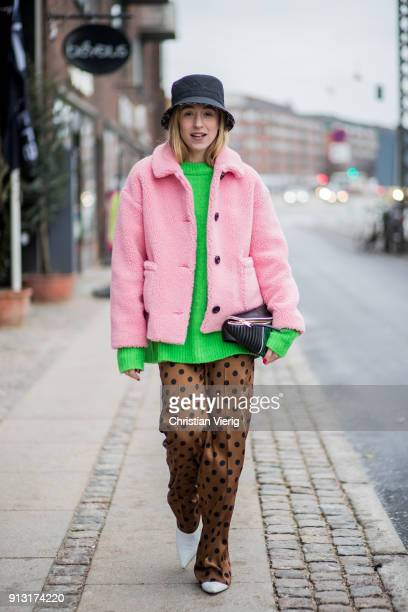 Sonia Lyson wearing bucket hat pink jacket green knit Miu Miu belt bag silk pants with dot print during the Copenhagen Fashion Week Autumn/Winter 18...