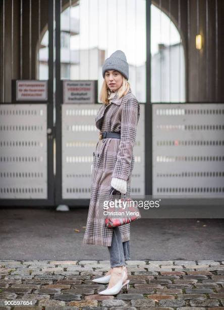 Sonia Lyson wearing checked trench wool coat Uterque white Mango shoes Fendi bag Citizen of Humanity jeans Gucci belt Acne beanie on January 2 2018...