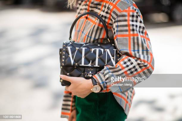 Sonia Lyson wearing dark green corduroy pants Isabel Marant beige turtleneck Zara checked shirt Zara neon yellow orange sneaker Adidas Valentino bag...
