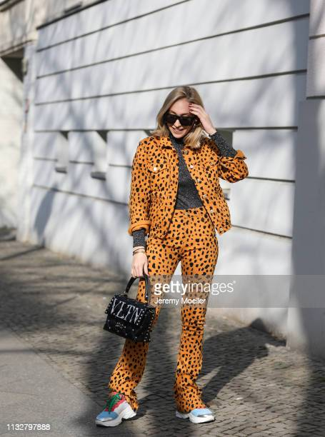 Sonia Lyson wearing Fabienne Chapot jacket and trousers Valentino bag and Zara eyewear on February 28 2019 in Berlin Germany