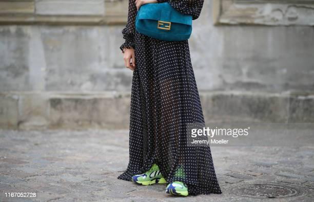 Sonia Lyson wearing Fendi bag, Dior sunglasses and Adidas sneaker on August 08, 2019 in Copenhagen, Denmark.