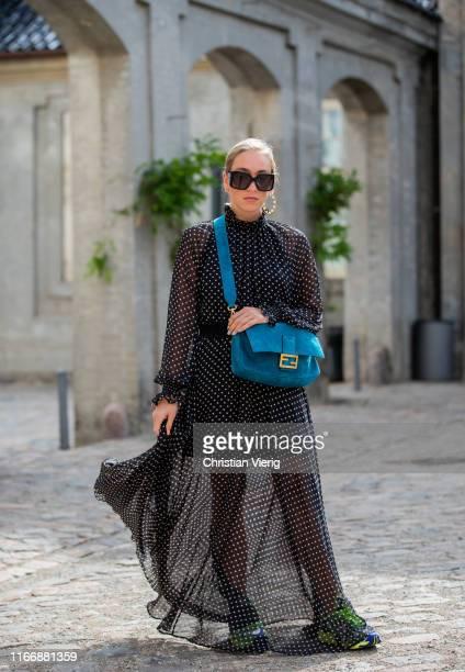 Sonia Lyson wearing Fendi bag, sheer dress is seen outside Designers Remix during Copenhagen Fashion Week Spring/Summer 2020 on August 08, 2019 in...