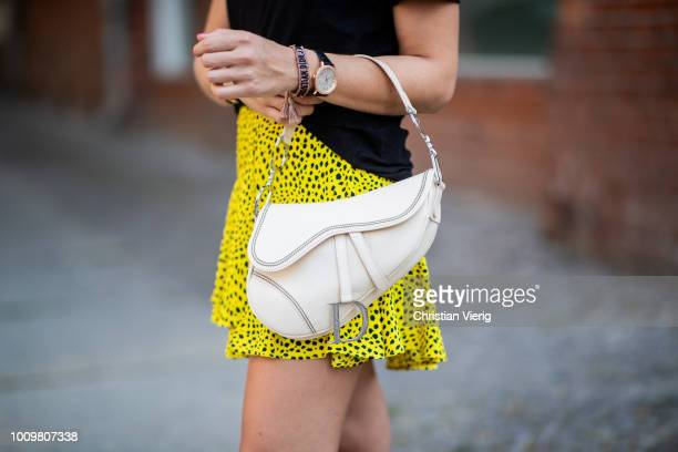 Sonia Lyson wearing fur sildes Ducie yellow mini skirt with dots print Topshop Dior Addict tshirt Dior saddle bag Wald Berlin earringnecklace Louis...
