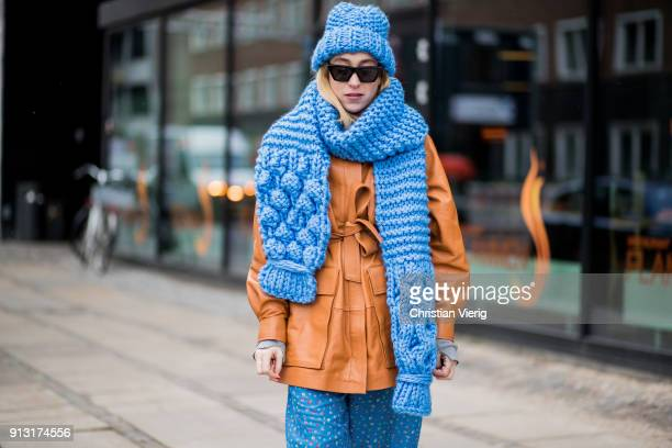Sonia Lyson wearing Ganni wool hat and scarf brown leather jacket Ganni pants white boots during the Copenhagen Fashion Week Autumn/Winter 18 on...