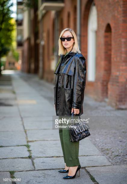 Sonia Lyson wearing green pants and top Edited Gianvito Rossi heels Valentino bag varnish parka Malaikaraiss Celine sunglasses on August 22 2018 in...