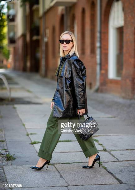 Sonia Lyson wearing green pants and top Edited Gianvito Rossi heels Valentino bag varnish parka Malaikaraiss Celine sunglasses on August 22 2018 in...