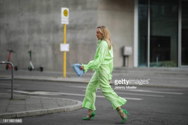 Sonia Lyson wearing green Restless sleepers linen two piece, green Bottega Veneta heels and blue mini pouch on April 08, 2021 in Berlin, Germany.