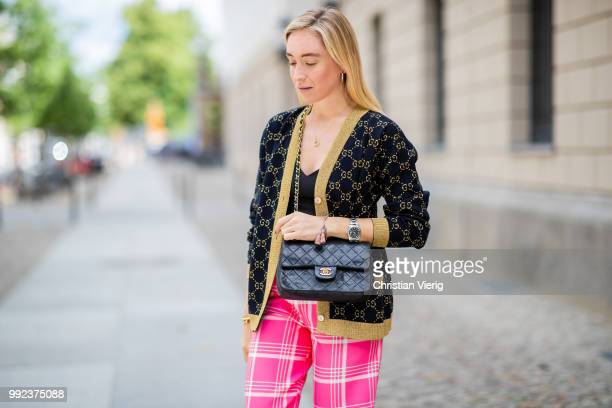 Sonia Lyson wearing Gucci cardigan pink plaid cropped pants Topshop vintage Chanel Gianvitto Rossi pumps cropped top Zara is seen during the Berlin...
