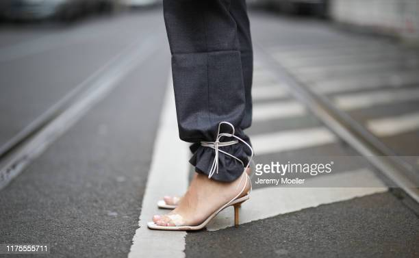 Sonia Lyson wearing Jacquemus mini bag, Dior sunglasses, Zara shoes, Edited pants, And other Stories blazer on September 13, 2019 in Berlin, Germany.