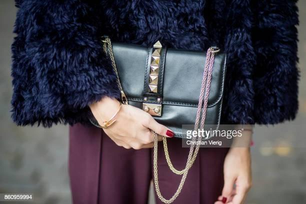 Sonia Lyson wearing Jimmy Choo boots with snake skin print navy fake fur cropped jacket Nobi Talai bordeaux pleated trousers Nobi Talai wool beanie...