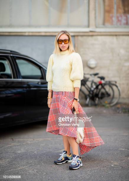 Sonia Lyson wearing knit asymmetrical checked pink skirt is seen outside Ganni during the Copenhagen Fashion Week Spring/Summer 2019 on August 9 2018...