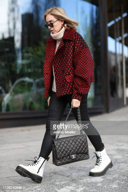 Sonia Lyson wearing LalaBerlin jacket sweater and trousers Zara Burberry sunglasses Doc Martens shoes and an earring from Waldberlin on February 08...