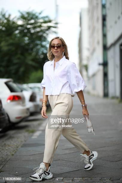 Sonia Lyson wearing Louis Vuitton Archlight Prada bag Rolex and Vogue eyewear sunglasses via Sunglass Hut on July 01 2019 in Berlin Germany