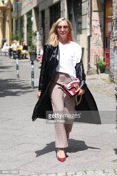 Sonia Lyson wearing Malaika Raiss trousers Pinko bag Chloe sunglasses and Dior shoes is seen during the MercedesBenz Fashion Week Berlin...