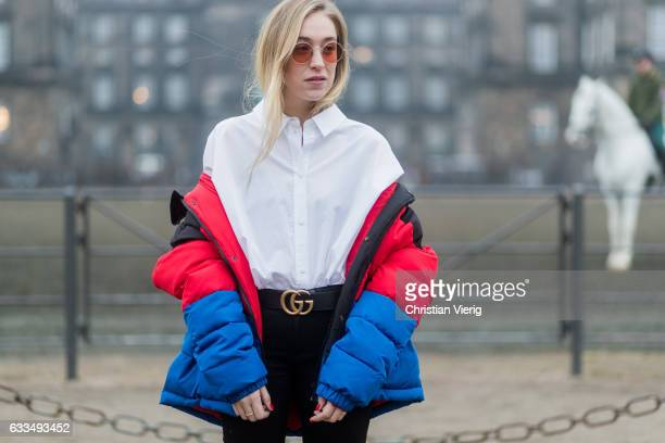Sonia Lyson wearing Mens shirt Weekday Stores Oversized Puff Jacket Urban Outfitters Belt Gucci High waisted skinny Jeans Acne Studios Patent Booties...